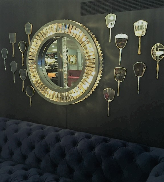 Gold Mirror Collection On A Dark Wall