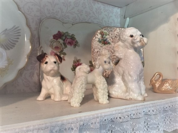 My little bunch of Kitsch n vintage ceramic dogs …. Poodle power!