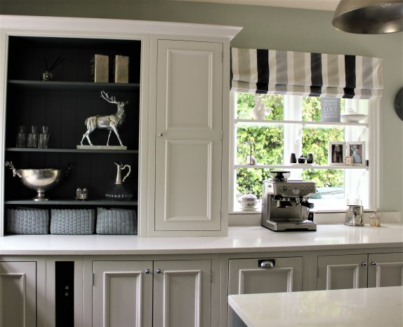 Kitchen cabinetry in Cornforth white and Downpipe by Farrow and Ball